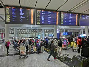 HK_Airport_Arrival_area_zone_interior_luggage_belt_information_display_monitors_n_visitors_Feb-2013