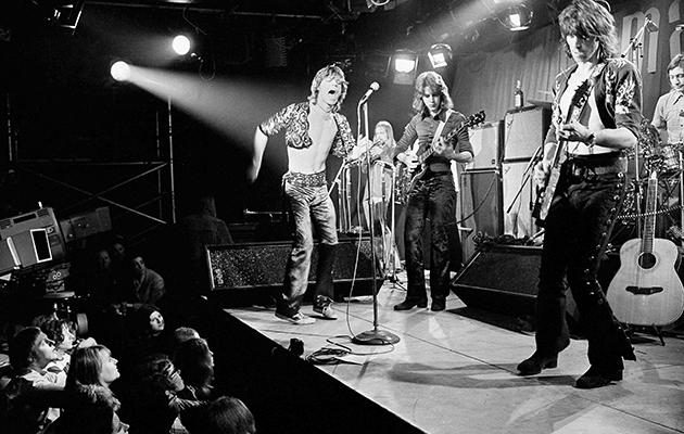 British rock and roll band The Rolling Stones are shown during their farewell performance at London's Marquee Club, Wardour Street, England, March 26, 1971. The band members are, from left, Mick Jagger, vocals; Mick Taylor, guitar; Keith Richards, guitar; and Charlie Watts, drums. The musician in background is unidentified. (AP Photo)