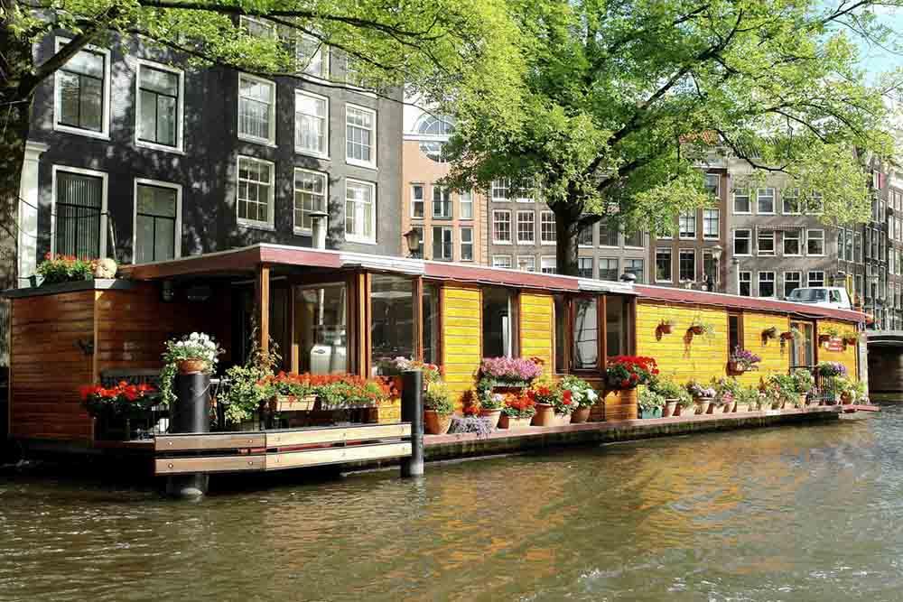 4 mete insolite per un viaggio alternativo tgtourism for Case galleggianti amsterdam